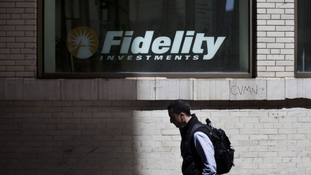 A pedestrian passes a Fidelity Investments branch in New York, U.S., on Monday, April 30, 2012.