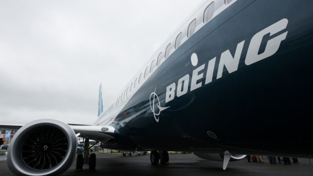 The Boeing Co. logo sits on the side of a 737 Max aircraft during preparations ahead of the Farnborough International Airshow 2016 in Farnborough, U.K.