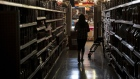 A customer shops for groceries at La Tapatia Market during a blackout in Napa, California on Oct. 9.