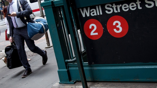 A pedestrian walks past the Wall Street subway station near New York Stock Exchange.
