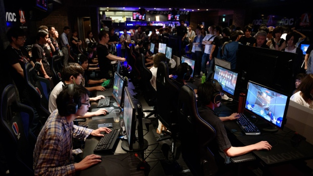 Attendees play Activision Blizzard Inc.'s Overwatch computer game at the AOC Open e-Sports event in Tokyo, Japan, on Saturday, July 1, 2017. Players in Japan, which held some of the world's first televised video-game battles in the 1980s, no longer has serious training grounds for its players. Laws meant to police organized crime and gambling have cast a net so wide they prevent paid gaming competitions.