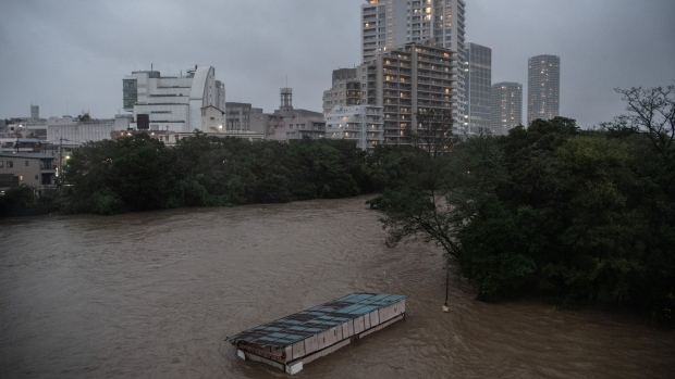 A cafe lies submerged as the Tama River floods on Oct. 12.