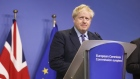 Boris Johnson pauses during a news conference in Brussels on Oct. 17.