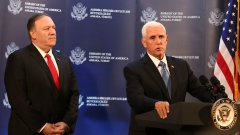 U.S Vice-president Mike Pence, right, talks to members of the media regarding his earlier meeting wi