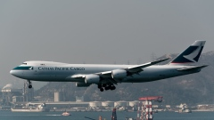 A Boeing Co. 747-867 cargo aircraft operated by Cathay Pacific Airways Ltd. prepares to land at Hong Kong International Airport in Hong Kong, China, on Saturday, March 11, 2018. Cathay Pacific is expected to report a full-year net loss of HK$2.7 billion ($345 million) for 2017, after a first-half deficit of HK$2.05 billion, according to the median estimate in a Bloomberg News survey of five analysts.