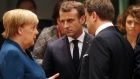 Angela Merkel, Germany's chancellor, left, speaks with Emmauel Macron, France's president, center and Xavier Bettel, Luxembourg's prime minister, ahead of round table talks at a European Union (EU) leaders summit in Brussels, Belgium, on Friday, Oct. 18, 2019. Prime Minister Boris Johnson's Brexit deal with the European Union was barely agreed before it ran into trouble at home, as his Northern Irish allies in parliament said they could not support it.