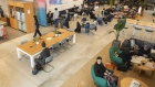 Members sit at the WeWork Cos. Iceberg co-working space in Tokyo.