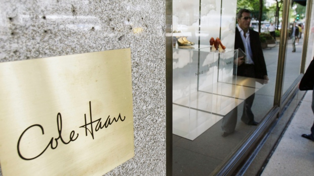 A man checks out the shoe display at the Cole Haan store on Chicago's Michigan Ave., Aug. 31, 2007.