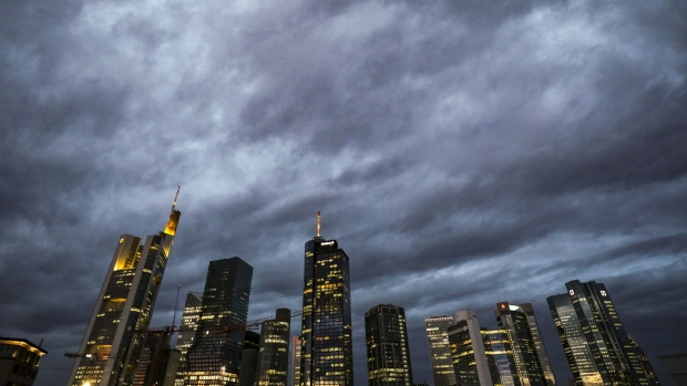 Skyscrapers including the Commerzbank AG headquarters, left, and twin tower headquarters of Deutsche Bank AG, right, stand illuminated at sunrise in the financial district of Frankfurt, Germany, on Monday, Oct. 21, 2019. U.K. Prime Minister Boris Johnson is making a fresh bid to deliver on his promise to take Britain out of the European Union on Oct. 31 amid mounting optimism that he now has the backing to get his deal through Parliament.