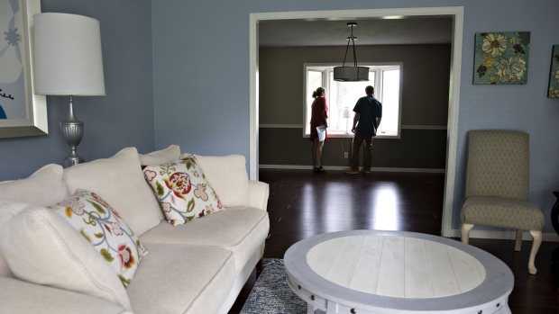 A real estate agent shows a prospective home buyer a house for sale in Peoria, Illinois. Photographer: Daniel Acker/Bloomberg