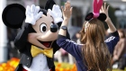 The Walt Disney Co. character Mickey Mouse greets a visitor at Tokyo Disneyland, operated by Oriental Land Co., in Urayasu city, Chia prefecture, Japan, on Friday, April 15, 2011.
