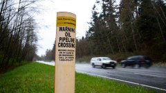 A petroleum pipeline crossing marker stands near the Kinder Morgan facility in Burnaby, British Columbia, Canada, on Wednesday, April 11, 2018.