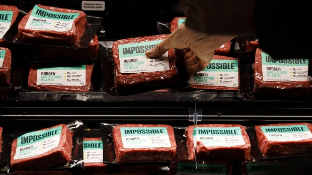 A customer picks up a package of Impossible Burger plant based meat during the Impossible Foods Inc.