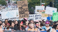 People march during a climate strike in Montreal, Sept. 27, 2019. The Canadian Press/Graham Hughes