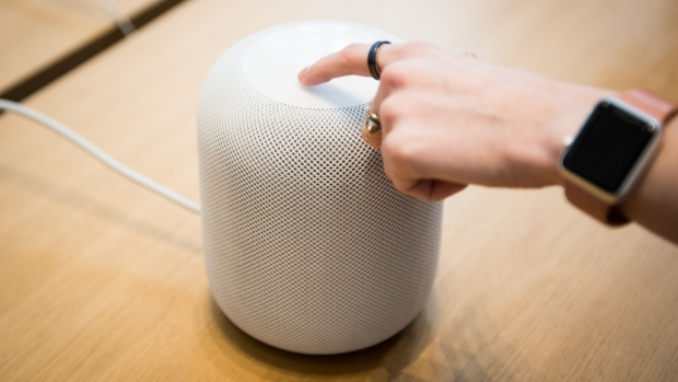 An employee demonstrates the HomePod speaker on the first day of sales at an Apple Inc. store in New