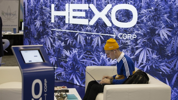 An attendee uses a laptop at the Hexo Corp. booth during the Montreal Cannabis Expo in Montreal, Que