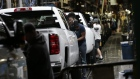 Workers inspect General Motors Co. (GM) Chevrolet 2019 Silverado HD and 2019 GMC Sierra HD pickup trucks on the assembly line at the GM plant in Flint, Michigan, U.S., on Tuesday, Feb. 5, 2019. GM is selling lots of expensive pickup trucks and sport utility vehicles in the U.S., which helped its average vehicle sales price hit a record $36,000. That played a big role in the better-than-expected quarterly earnings.