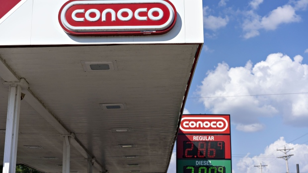 Signage is displayed at a Conoco gas station in Peoria, Illinois, U.S.