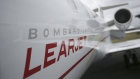 A logo sits on the side of a Learjet 45XR aircraft, manufactured by Bombardier Inc., on the second d