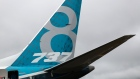 The tail fin of a Boeing Co. 737 Max Aircraft stands on display during preparations ahead of the Farnborough International Airshow 2016 in Farnborough, U.K.