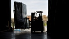 An employee moves an order of walls on a forklift in Baltimore, Maryland.