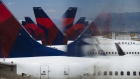 Delta Air Lines Inc. planes are seen reflected at Salt Lake City International airport (SLC) in Salt Lake City, Utah, U.S., on Thursday, July 5, 2018. Delta Air Lines Inc. is scheduled to release earnings figures on July 12.