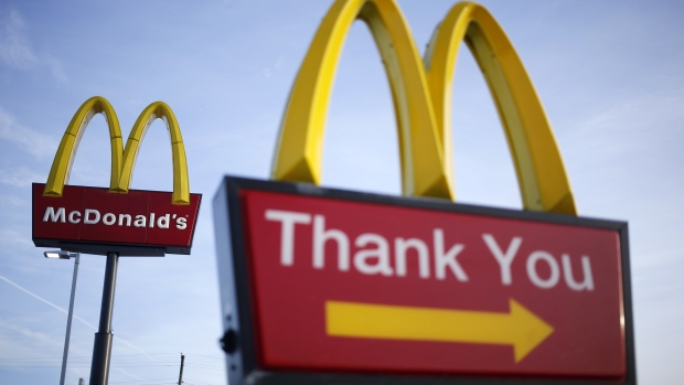 Signage is displayed outside a McDonald's Corp. fast food restaurant in Carrolton, Kentucky, U.S.