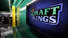 In this May 2, 2019, file photo, the DraftKings logo is displayed at the sports betting company head