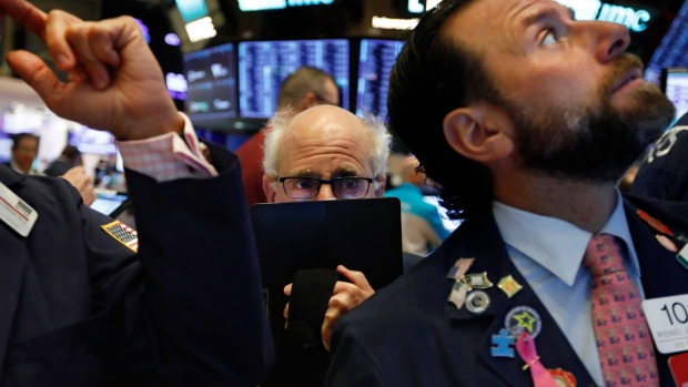 Trader Peter Tuchman, center, works on the floor of the New York Stock Exchange, Nov. 4, 2019.