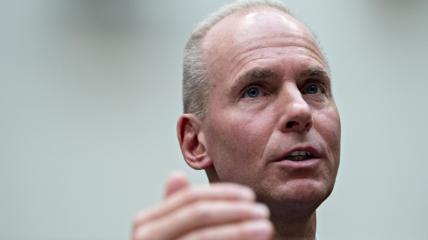 Boeing chairman praises CEO Muilenburg, signals he will stay