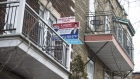 "A ""For Sale"" sign is displayed outside a home in the Le Plateau Mont-Royal borough of Montreal, Quebec, Canada, on Saturday, April 14, 2018. An economic revival in Canada's second-biggest city is fueling a real-estate renaissance, speeding up sales, shrinking inventories, and luring foreign buyers."