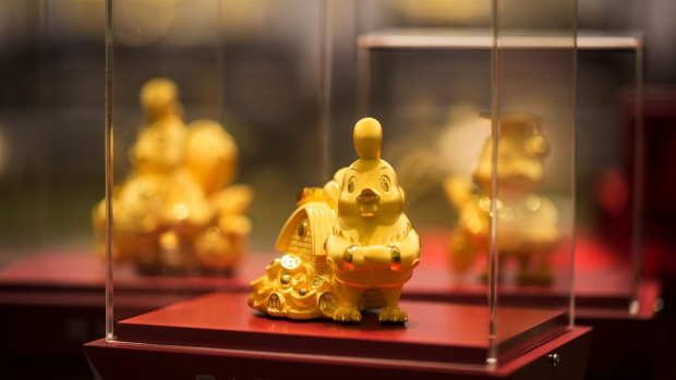 Gold chick figurines sits on display inside a Chow Tai Fook Jewellery Group Ltd. store in the Central district of Hong Kong, China, on Friday, Jan. 20, 2017. Chow Tai Fook, the world's largest jewelry chain, last year launched the first of a line of mainland shops selling lower-priced jewelry, with average prices of 2,000 yuan ($291), about a third the prices at its flagship stores.