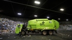 A GFL Environmental Inc. garbage truck prepares to drop off a load of waste at a transfer station in