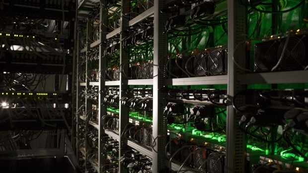 Cryptocurrency mining rigs operate in a cargo container at the Golden Fleece cryptocurrency mining company in Kutaisi, Georgia, on Monday, Jan. 22, 2018. Golden Fleece uses a cargo container with Chinese-built computers inside a dilapidated Soviet-era tractor factory to extract cryptocurrencies using low-cost electricity generated by water flowing from the nearby Caucasus Mountains.