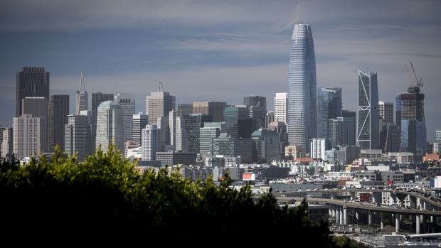 The Salesforce Tower, center right, stands in San Francisco, California, U.S., on Thursday, May 10, 2018. The building, the tallest office tower west of the Mississippi river, opened with a ceremony crowded with local officials on Tuesday, representing the indelible mark San Francisco's largest private employer has made on the city. Photographer: David Paul Morris/Bloomberg