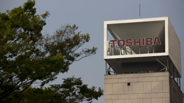 Signage for Toshiba Corp. is displayed at the company's headquarters in in Tokyo, Japan, on Tuesday, April 3, 2018. Toshiba is sticking with its plans to sell its memory chip unit despite regulatory hurdles, Kurumatani said.