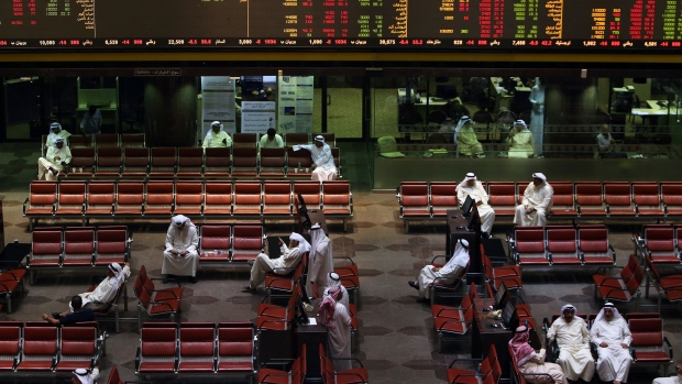 Kuwaiti traders follow the stock market at the Kuwait Stock Exchange (KSE) in Kuwait City on October 14, 2017.