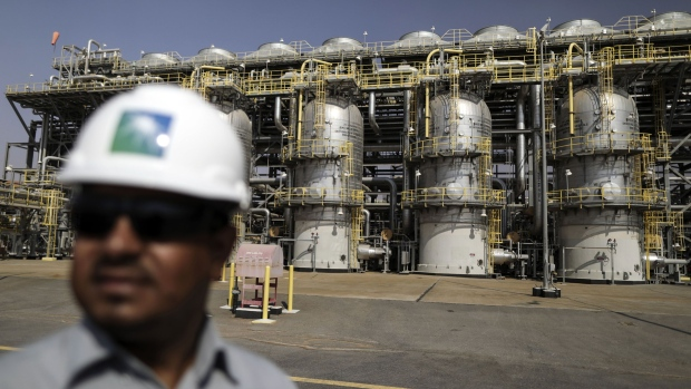 An employee visits the natural gas liquids ngl facility at saudi aramco s shaybah oil field in the rub al khali desert also known as the empty quarter in shaybah saudi arabia on tuesday oct 2 2018 saudi arabia is seeking to transform its crude dependent economy by developing new industries and is pushing into petrochemicals as a way to earn more from its energy deposits