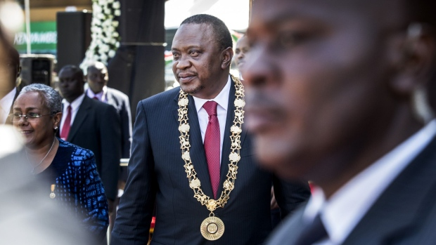 Uhuru Kenyatta, Kenya's president, attends the independence celebrations on Jamhuri Day at Kasarani stadium in Nairobi, Kenya, on Tuesday, Dec. 12, 2017. Kenya's main opposition alliance postponed indefinitely plans to swear-in its leader as president of a so-called People's Assembly, after the government warned such a step would amount to treason. Photographer: Luis Tato/Bloomberg