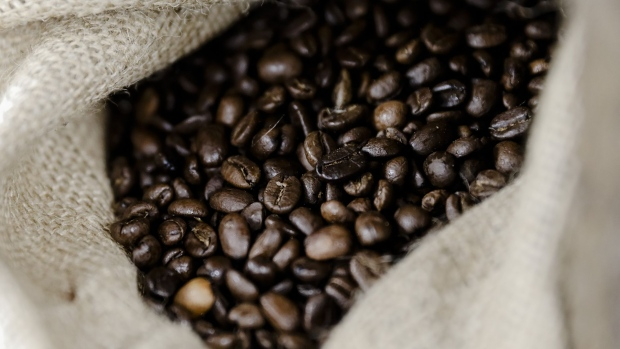 Coffee beans sit in a hessian sack inside the Carte Noire factory in Laverune, France, on Tuesday, May 16, 2017.