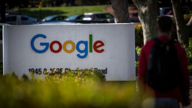 A pedestrian walks past signage at Google Inc. headquarters in Mountain View, California.