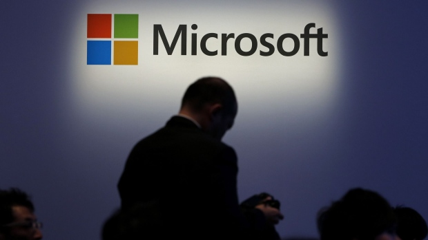 The Microsoft Corp. logo is displayed at a launch event for the company's Windows 8.1 operating system in Tokyo, Japan.