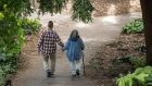 An elderly couple holds hands while walking on a path at Golden Gate Park in San Francisco, California, U.S., on Thursday, June 21, 2018. The Labor Department rule, aka the fiduciary rule conceived by the Obama administration, was meant to ensure that advisers put their clients' financial interests ahead of their own when recommending retirement investments has been killed by the Trump administration.