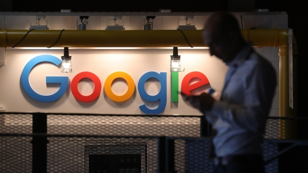A sign featuring Google Inc.'s logo stands inside the entrance to their new U.K. headquarters at Six St Pancras Square in London, U.K.