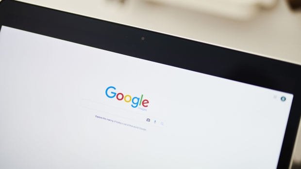 The Google Inc. homepage is displayed on an Apple Inc. laptop computer in this arranged photograph taken in the Brooklyn borough of New York, U.S., on Friday, July 19, 2019. Alphabet Inc. is scheduled to release earnings figures on July 25.