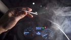 In this photo illustration, vapor from a cannabis oil vaporizer is seen as the driver is behind the