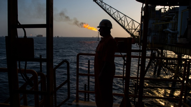 Gas flares burn from pipes aboard an offshore oil platform in the Persian Gulf's Salman Oil Field, operated by the National Iranian Offshore Oil Co., near Lavan island, Iran, on Thursday, Jan. 5. 2017. Nov. 5 is the day when sweeping U.S. sanctions on Iran's energy and banking sectors go back into effect after Trump's decision in May to walk away from the six-nation deal with Iran that suspended them.