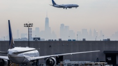 A United Continental Holdings Inc. airplane prepares for landing as the New York City skyline stands in the background at Newark Liberty International Airport (EWR) in Newark, New Jersey, U.S.