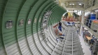 An employee works on a section of fuselage inside the new Airbus SE A320 passenger aircraft family assembly line hangar in Hamburg, Germany, on Tuesday, Oct. 1, 2019. An escalating battle over aircraft subsidies between the U.S. and the European Union threatens to damage both sides, said Airbus Chief Executive Officer Guillaume Faury.
