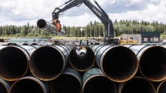 Pipe for the Trans Mountain pipeline is unloaded in Edson, Alta., June 18, 2019. The Canadian Press